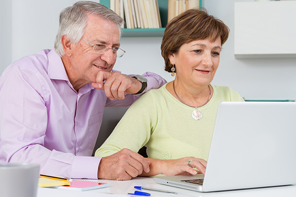 Middle aged couple attending virtual workshop